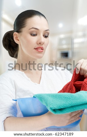 Girl with a basin full of laundry