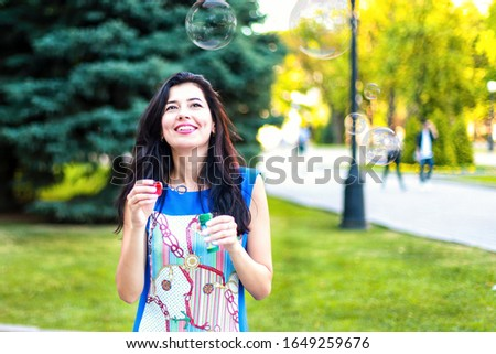 girl with a beautiful smile, soap bubbles