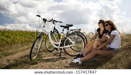 Girl with a bicycle enjoying