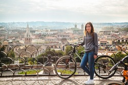 Girl with a bicycle in Rome, Italy
