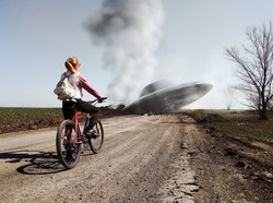Girl with a bicycle standing near a wrecked UFO. Photo with 3d rendering elements