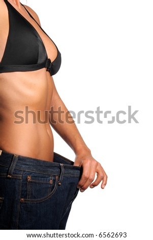 Girl with a bikini and belly with big jeans showing weight loss.
