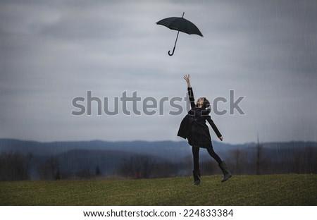 Stock Photo girl with a black umbrella in the rain