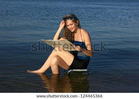 Girl with a book on the beach