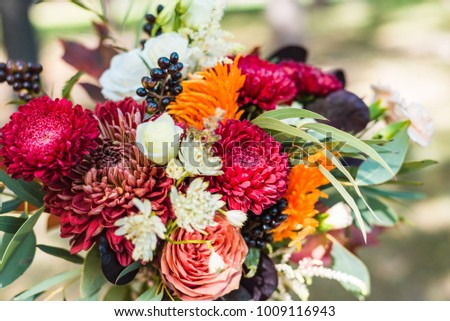 Girl with a bouquet of flowers, an autumn bouquet of flowers, a wedding bouquet