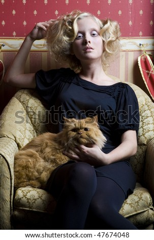 Girl with a cat in interior