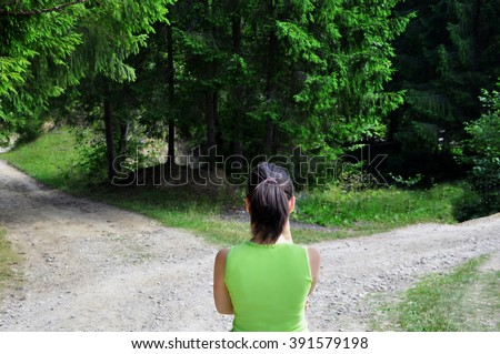 Girl with a choice near the forked road #391579198