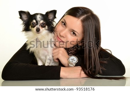 Girl with a dog a white background.decorative dog.chihuahua