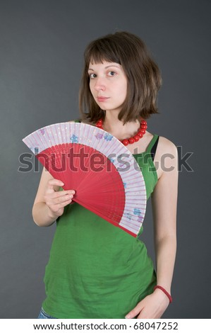 girl with a fan on a black background