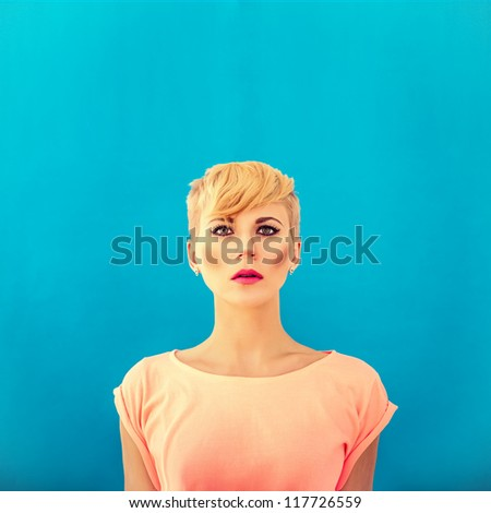 girl with a fashionable hairstyle on a blue background