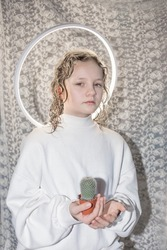 girl with a halo holds a holy cactus