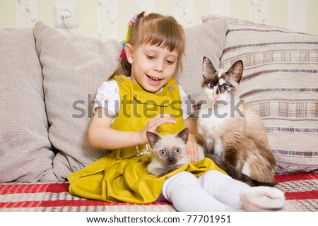 Girl with a kitten in her arms