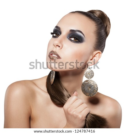 girl with a long hair and beautiful face with smoky eyes - stock photo