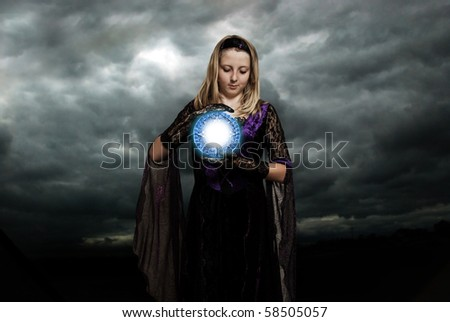 girl with a magic talisman in her hands