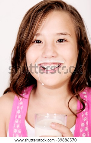 Girl with a milk mustache. 10 years