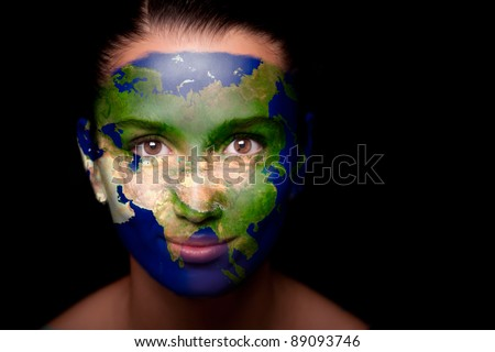 Girl with a painted map of Asia on his face. Closeup.