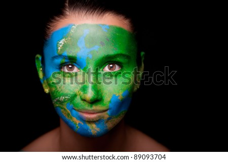 Girl with a painted map of Europe on his face. Closeup.