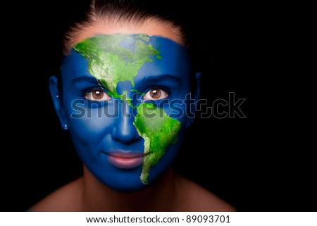 Girl with a painted map of North and South America in the face.
