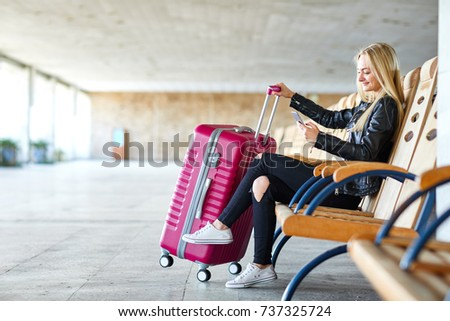 girl with a pink suitcase at...