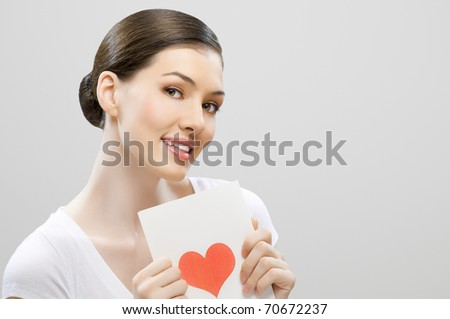 girl with a postcard in his hand