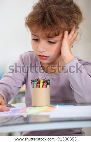 Girl with a pot of crayons