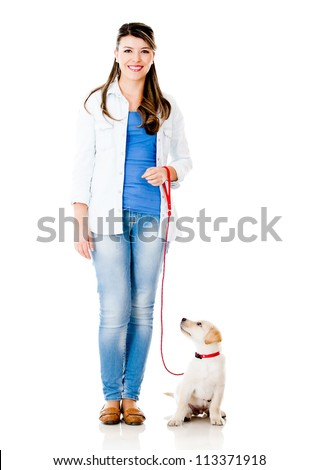 Girl with a puppy dog on a leash - isolated over a white background