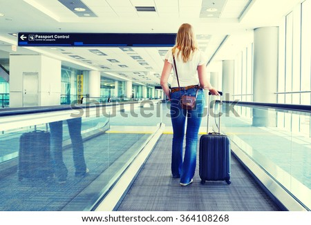 Girl with a suitcase on the speedwalk #364108268