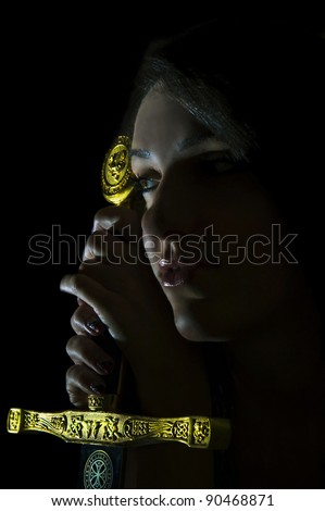 Girl with a sword on a black background