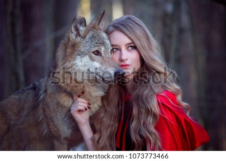 girl with a wolf in a red cloak