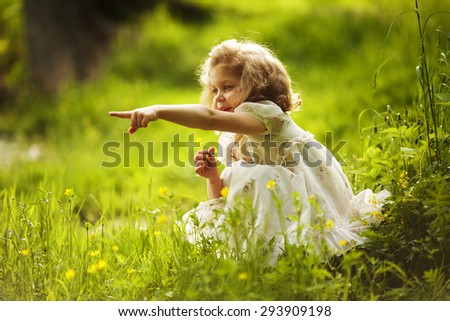 Girl with a yellow flower indicates somewhere hand