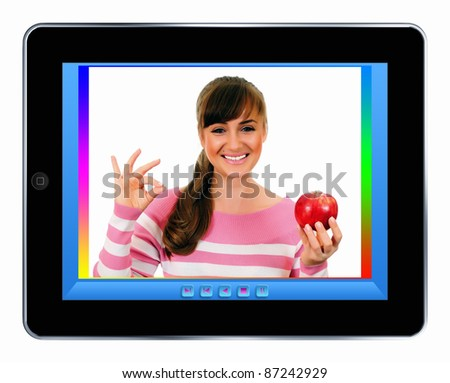 girl with apple on a tablet pc screen