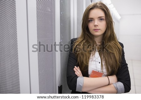 Girl with arms crossed  working at data storage facility