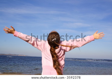 Girl with arms out loving life