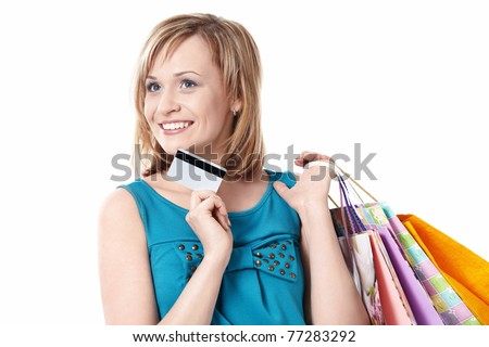 Girl with bags and credit card on a white background