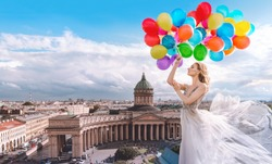 Girl with balloons in a waved dress on the background of St. Petersburg, Russia. Kazan Cathedral