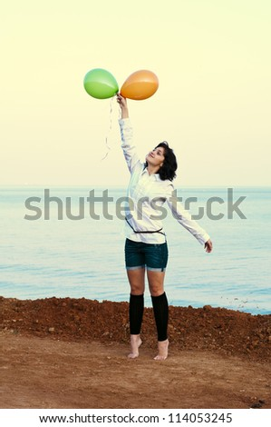 girl with balloons on the head