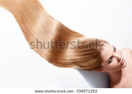 Girl with beautiful hair on a white background
