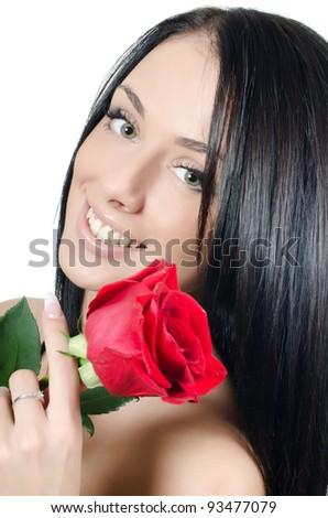 Girl with beautiful hair with red rose