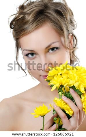 Girl with beautiful hair with yellow chrysanthemum