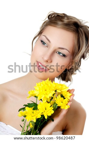 Girl with beautiful hair with yellow chrysanthemum