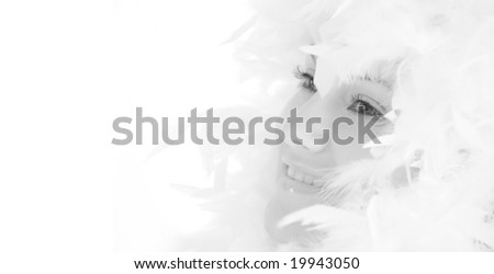Girl with beautiful make up and white feathers #19943050