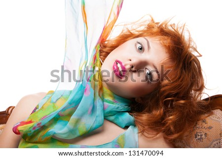 Girl with beautiful red hair and colorful dress and fabric over white background #131470094