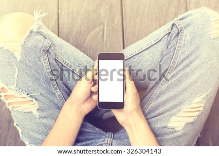 Girl with blank screen of smartphone, mock up #326304143