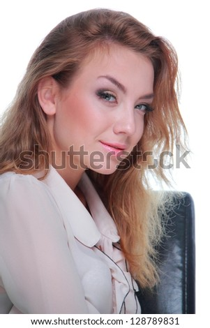 Girl with blond hair posing sitting on a chair/Close up portrait of young stylish woman