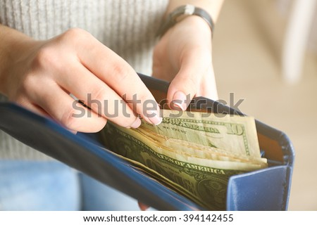 Girl with blue wallet full of money