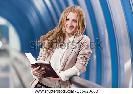 girl with book/ girl holding red book