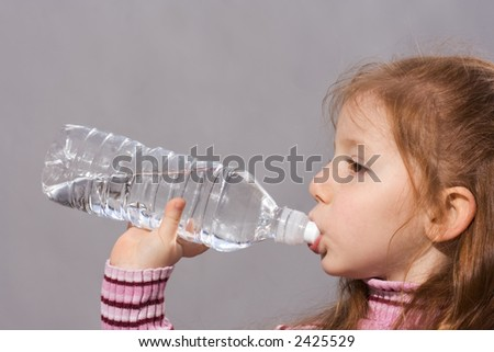 Girl with bottle of fresh water