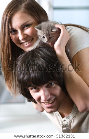 Girl with boy and kitten