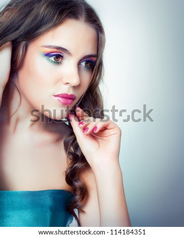 girl with bright makeup and long hair