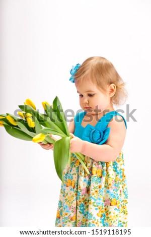 Girl with bunch of tulips Zdjęcia stock ©